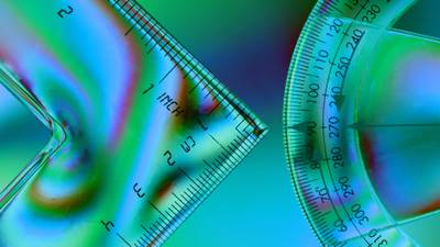 Abstract image of geometry instruments on a polarized background